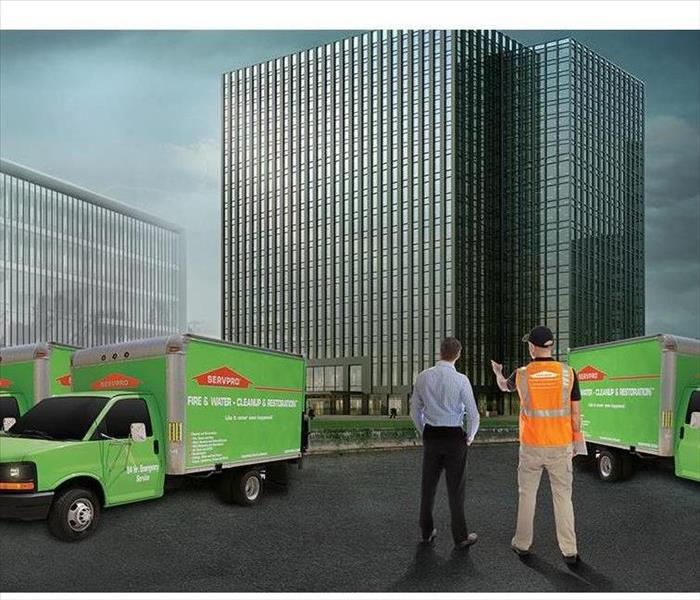 SERVPRO employees are standing in front of a commercial structure